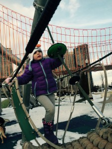 5 year old, Elli, climbing on rope bridge at Millennium Park